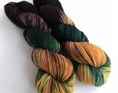Hand dyed superwash merino dk wool yarn. Variegated double knit wool yarn, Mutiny, merino wool yarn, mustard yellow, dark brown, teal green.
