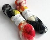 Hand dyed yarn, singles superwash merino 4ply wool yarn, red black yarn, soft wool yarn, fingering, knitting, crochet, sock, variegated.