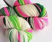 Hand dyed superwash merino dk wool yarn. Variegated double knit wool yarn, Whoville, greens, hot pink, and white indie dyed DK merino yarn.