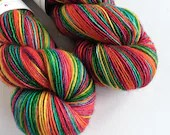 Hand dyed variegated rainbow, singles superwash merino/sparkle sock/4ply/fingering weight yarn. Sparkle singles yarn for knitting, crcohet