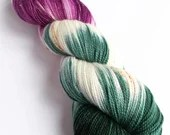 Indie dyed superwash merino/nylon/stellina sparkle sock yarn.  Hand dyed variegated green, plum and speckled yarn in colourway 'Luna'.