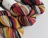 Hand dyed superwash merino dk yarn. Variegated double knit wool yarn, red black grey gold merino wool yarn, sw merino dk knitting wool.
