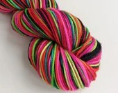 Hand dyed superwash merino worsted weight wool yarn. Hair Up variegated vibrant pink rainbow wool yarn for knitting or crochet.