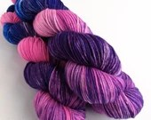 Hand dyed superwash merino/nylon dk wool, variegated double knit. Exclusive OOAK colourway in bright pink, purple and blue.