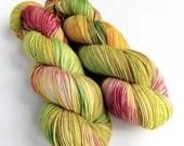 Hand dyed silver sparkle sock yarn, superwash merino/nylon/stellina sparkle sock/fingering yarn. Boneappletea OOAK greens, yellows, pinks.