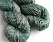 Hand dyed single ply superwash merino/yak/silk yarn, gentle turquoise 4ply/fingering weight. 120g/480m.