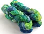 Hand dyed yarn, singles superwash merino 4ply wool yarn, variegated greens blues yellow, speckles, fingering, knitting, crochet, indie dyed