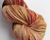 Hand dyed superwash merino/nylon dk wool, variegated double knit. Nutkins, autumn coloured thick sock yarn.