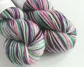 Hand dyed yarn, single ply superwash merino dk wool yarn, purple pink green yarn. double knit, knitting, crochet, variegated yarn, indie dye