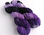 Hand dyed superwash merino dk wool yarn. Variegated double knit wool yarn, purple, black and white indie dyed DK merino yarn.