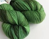 Hand dyed sock yarn, variegated merino sock yarn, superwash merino/nylon 4ply, fingering weight yarn.  Neville sock yarn, greens and browns.
