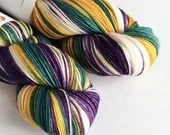 Hand dyed variegated 75/25% superwash BFL/nylon sock/fingering/4ply weight yarn, Yule yarn, purple, teal green, gold, white sock yarn.