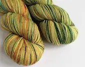 Hand dyed variegated 75/25% superwash merino/nylon sock fingering 4ply weight yarn, Autumnal greens and oranges. OOAK Just For Fun yarn.