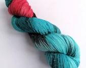 Hand dyed sparkle sock yarn, superwash merino/nylon/stellina sparkle sock/fingering yarn. Astral, blue red black, Cosmos sock yarn.
