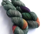 Hand dyed single ply superwash merino/yak/silk yarn, variegated green with a rainbow. 4ply/fingering weight. 120g/480m.