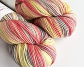 Hand dyed superwash merino dk wool yarn. Variegated double knit wool yarn, Piffle, pastel red, yellow, beige indie dyed DK merino yarn.