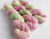 Hand dyed yarn, singles superwash merino/sparkle 4ply/fingering wool yarn. pastel pink and green yarn, speckled 4ply, speckled singles.