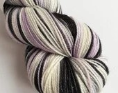 Indie dyed silver sparkle sock yarn, superwash merino/nylon/stellina sparkle sock yarn.  Buckbeak sock yarn, purple black silver white yarn.