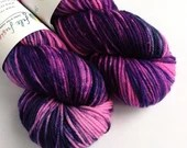 Hand dyed sw merino/nylon dk wool, variegated hot pink and purple double knit.  Collywobbles thick sock yarn for knitting or crochet.