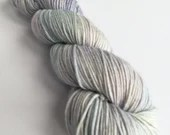 Hand dyed silver sparkle DK yarn, superwash merino/nylon/stellina double knit yarn, indie dyed yarn. The Boy Who Lived, pale blue and lilac.