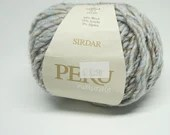 deSTASH yarn, Sirdar Peru naturals, knitting yarn, bulky yarn, crochet yarn, pale blue brown yarn, wool blend yarn, multicolored yarn, knit