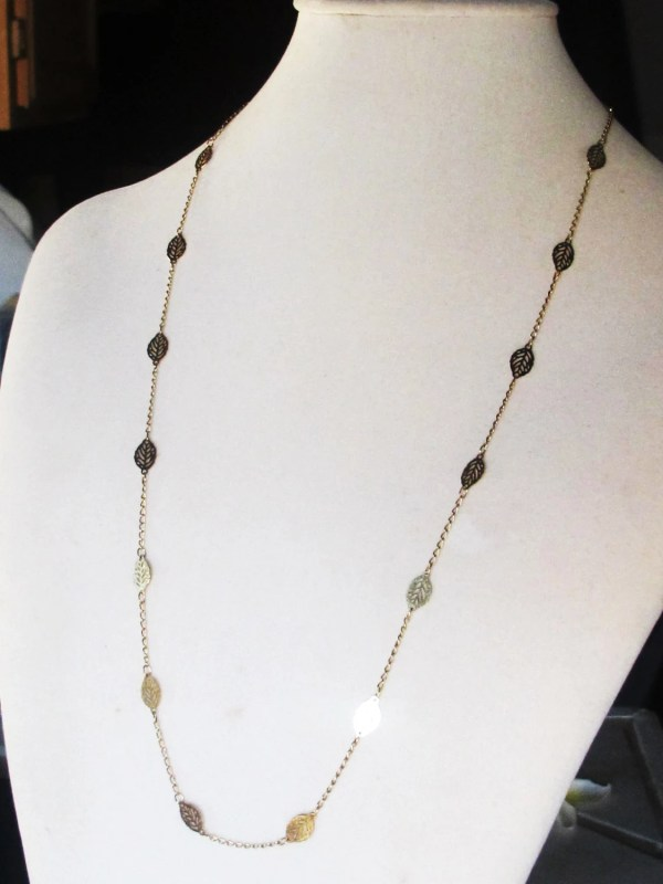 Gold Cougar Town Long Necklace With Shiny Leaf Discs