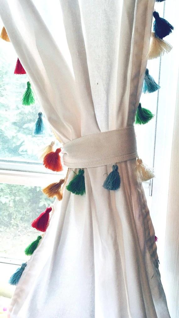 white cotton curtain with rainbow tassel trim