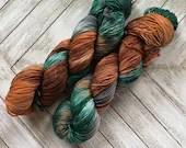 In Stock | Hand Dyed Yarn | Indie Dyed | Fingering Weight | Superwash Merino Wool | Variegated | Grey | Evergreen | Brown | Orange
