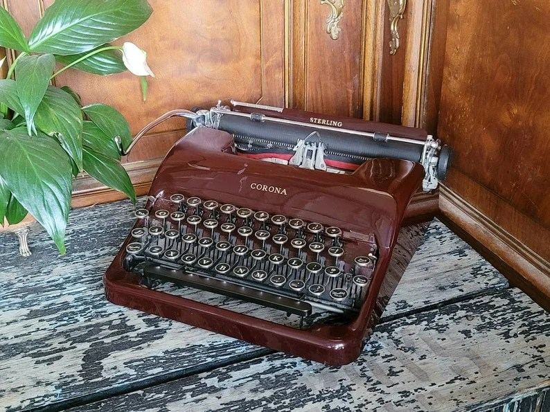 Vintage 1930s Burgundy Corona Sterling Typewriter With Glass image 0