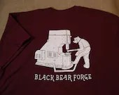Bear working with power hammer. Black Bear Forge Tee shirt