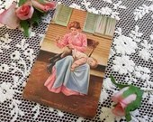 Antique 1907 Edwardian Color Art Postcard Post Card 1900s Mother at Home outside Sewing her Little Boys Torn Pants while He Waits Nursery