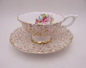 Vintage Guaranteed English Bone China Gold Chintz Floral  Footed Teacup and Saucer