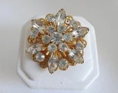 Vintage Clear Faceted Marquis and Round Rhinestone Brooch Pin on a Gold Tone Setting is an Elegant and Classic Accessory