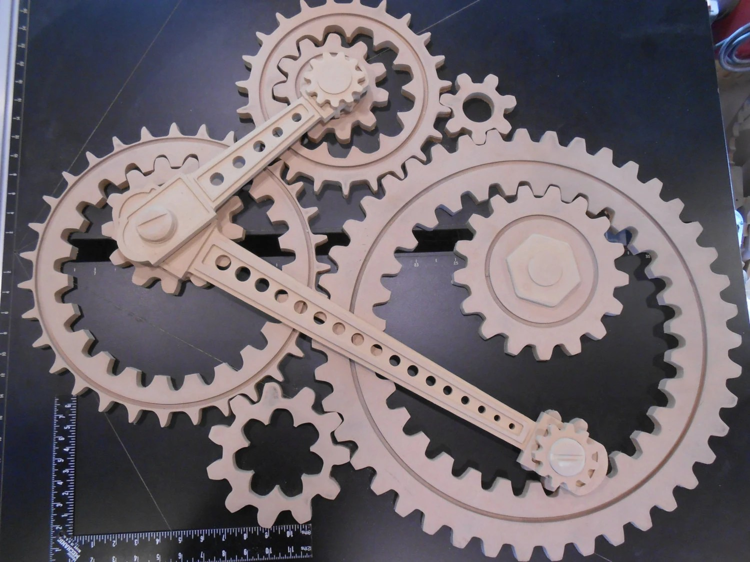 wooden gear sculpture in