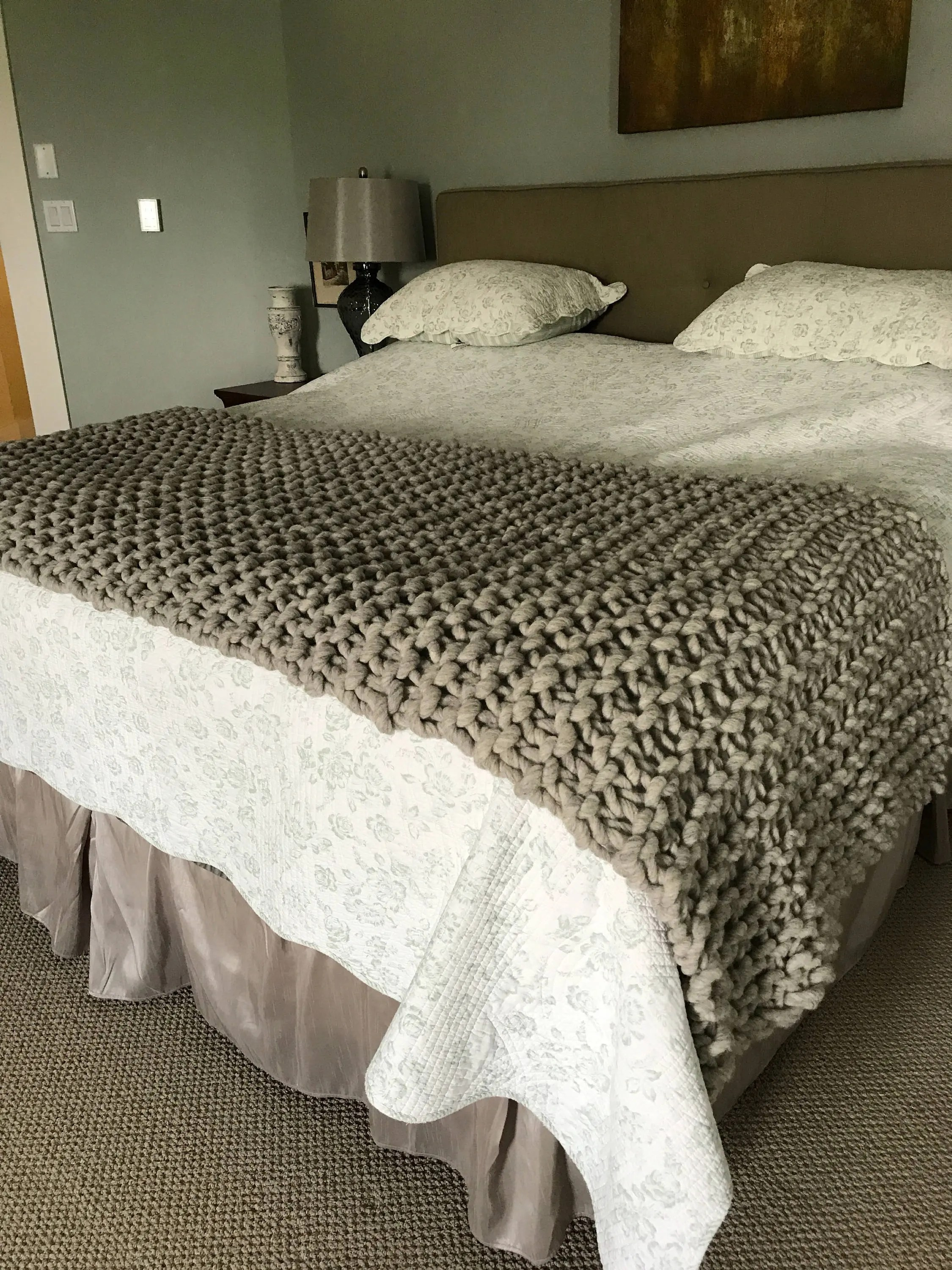 chunky wool knit bed runner for a queen or king bed it is a beautiful luxury knitted blanket knit with handspun yarn