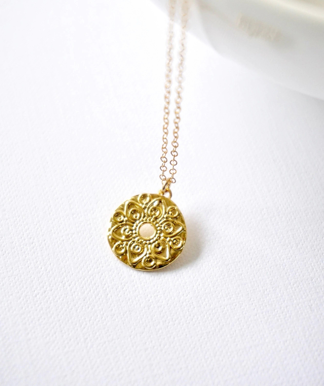 gold round flower medallion