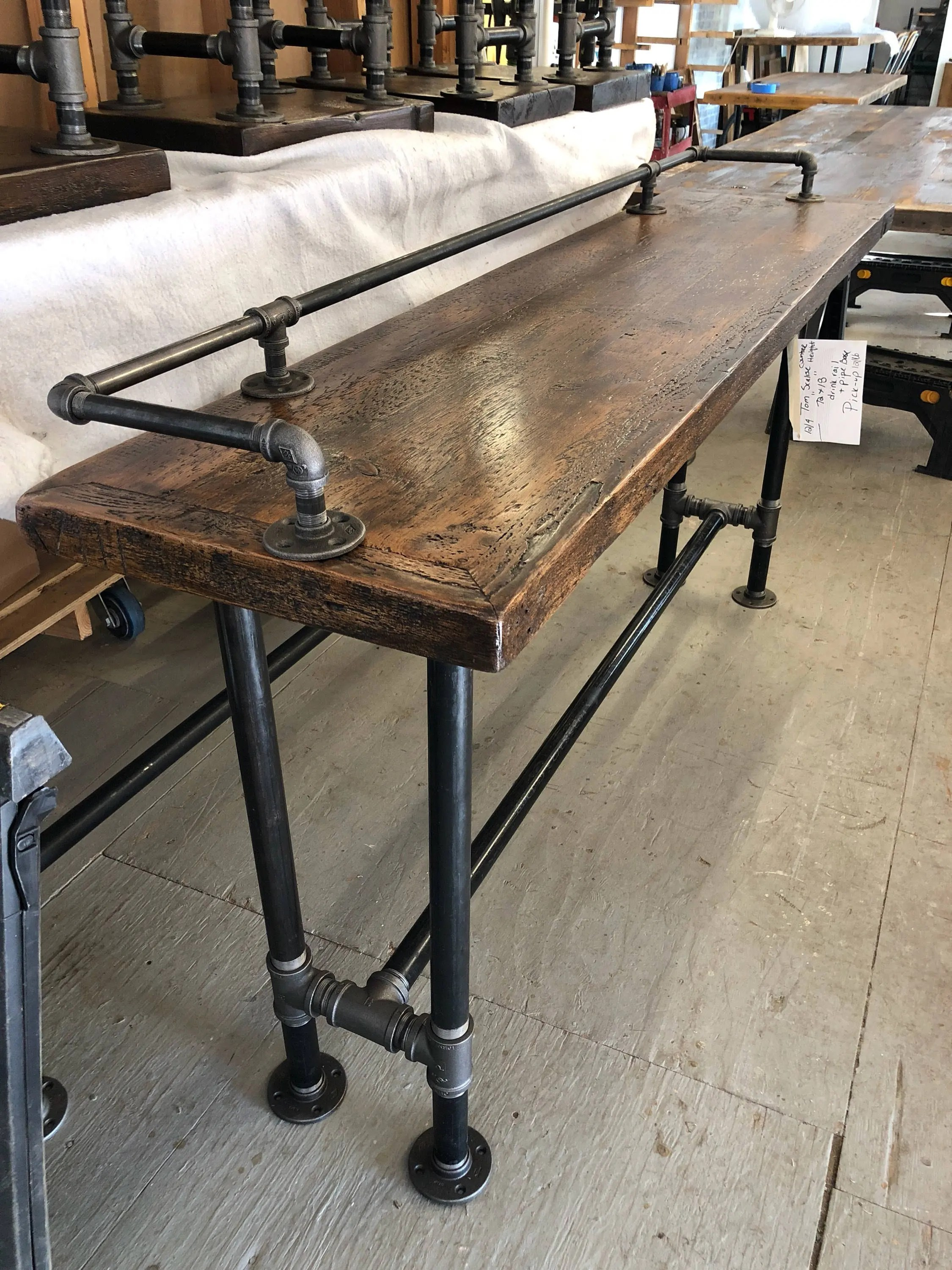 wooden sofa table legs cindy crawford home montclair bar tablerustic wood console pipe etsy reclaimed man cave media metal and rail