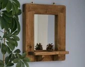 Wooden wall mirror with s...