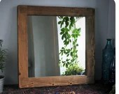 wooden wall mirror with t...