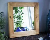 wooden wall mirror with d...
