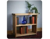 low wooden bookshelf, boo...