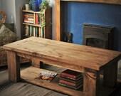 Long coffee table in light natural wood, wide chunky table legs, low magazine shelf, modern rustic farmhouse, custom handmade in Somerset UK