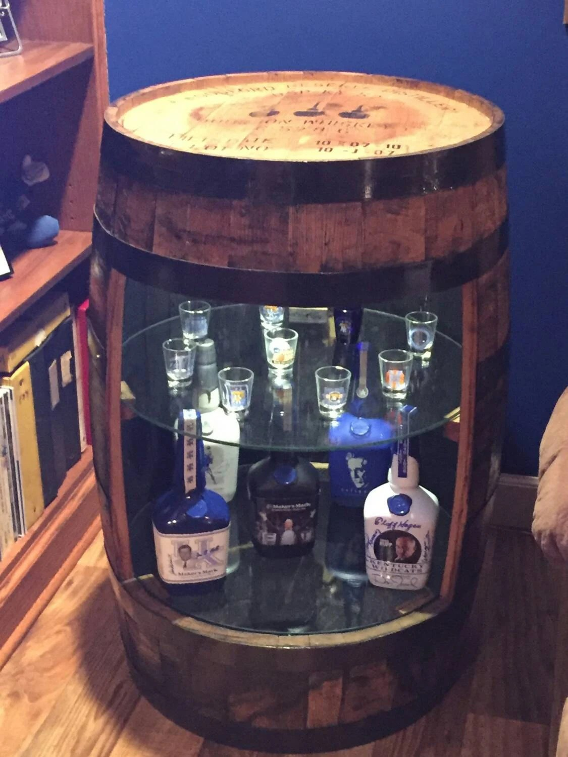 Bourbon barrel display cabinet with glass shelves and