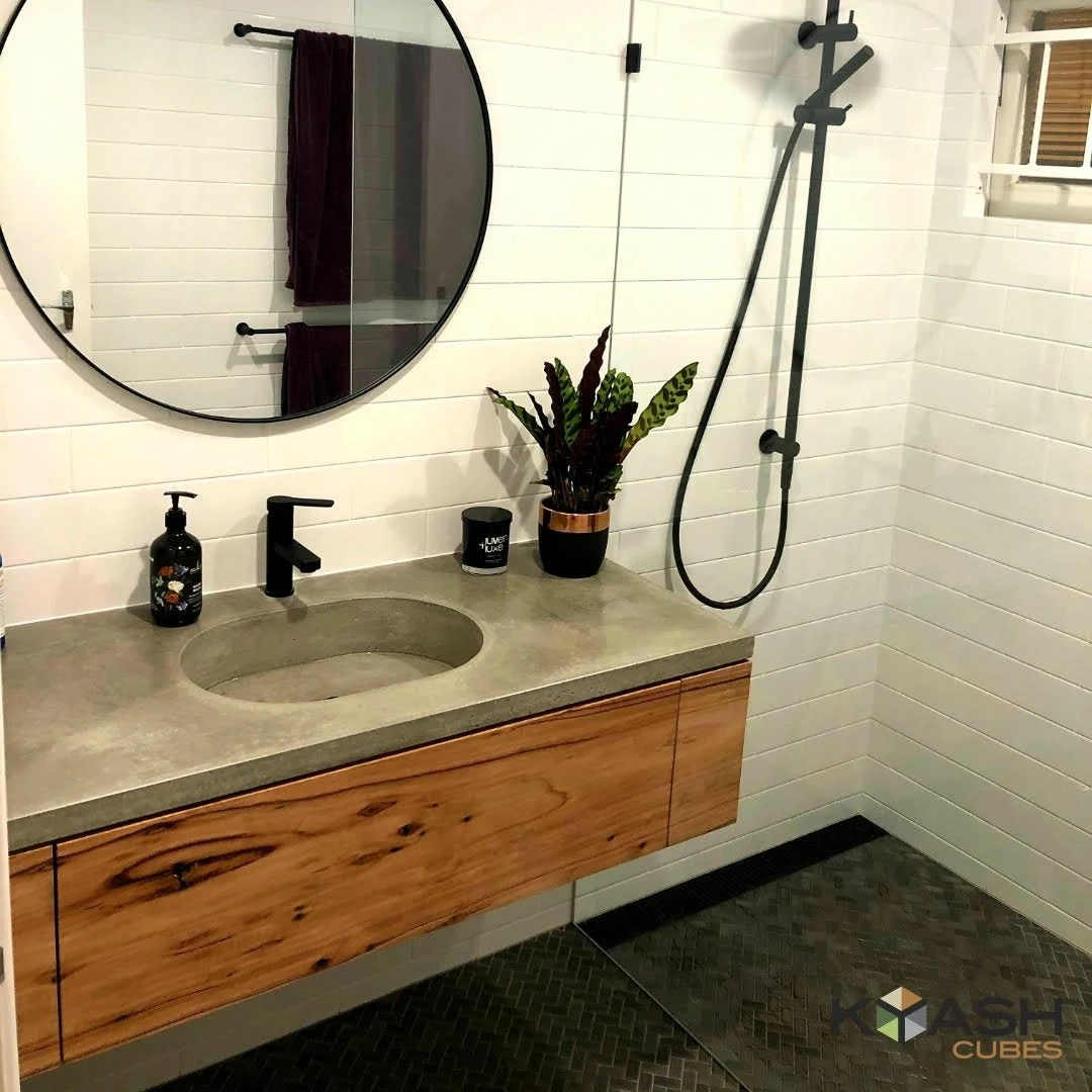 floating polished concrete vanity round basin custom handmade real concrete bathroom or ensuite with hardwood cabinetry and single drawer