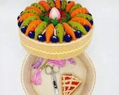 fake fruit cake, round box of felt