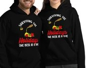 Surviving The Holidays One Beer At A time Funny Christmas Unisex Hoodie