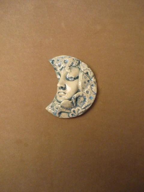 Ornate moon star face pro...