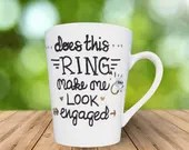 Engagement Coffee Mug - Does this ring make me look engaged - Proposal and engagement announcement coffee mugs.