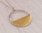 Long recycled silver circle necklace with semi circle/half moon silver or brass patterned petal leaf imprint
