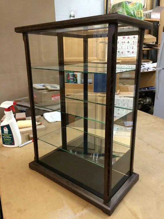 vitrine en bois et verre pour poupees modeles figurines en cristal wenge autres bois exotiques disponibles